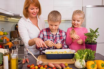 Mother and children preparing meal